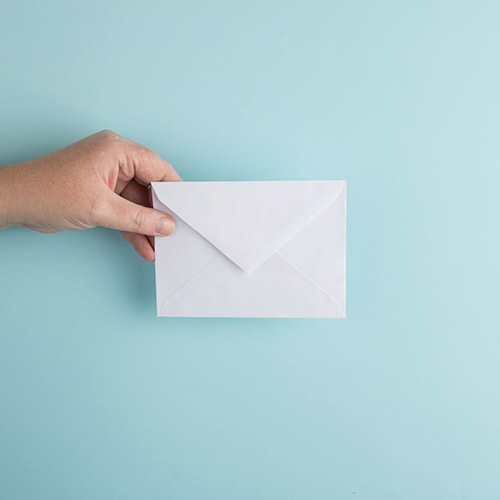 Person holding envelope