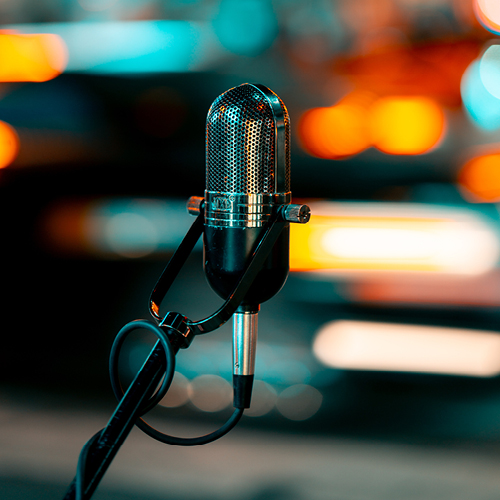 Microphone on a stand with colorful background