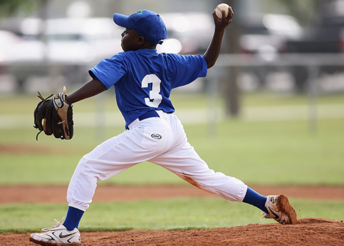 boy-wearing-blue-and-white-3-jersey-about-to-pitch-a-209975