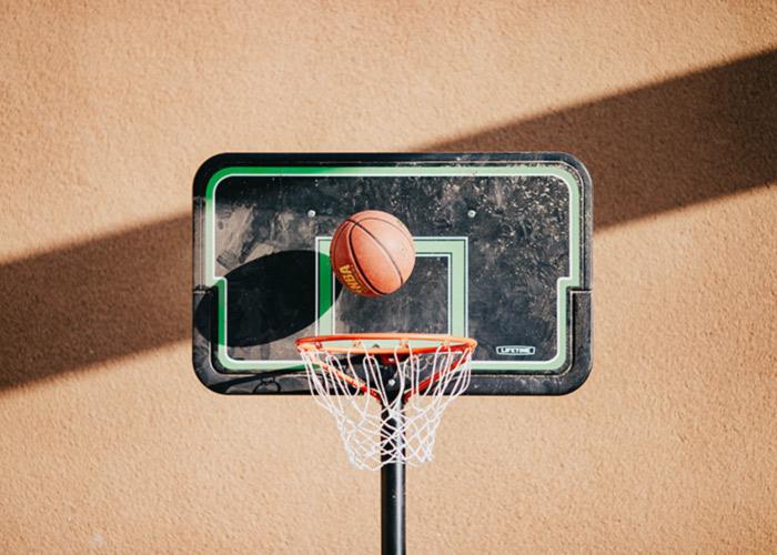 Basketball going through a basketball goal