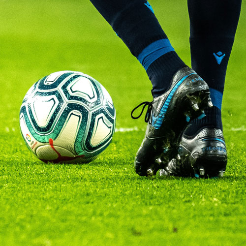soccer ball and cleats of player